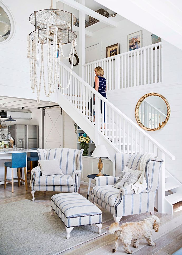 """The double-height ceiling was inspired by a cathedral ceiling Martyn once saw in a tiny Paddington terrace. """"The reason the home felt so big was because of the height,"""" he recalls. New double-sized French provincial-style lounge chairs from Côté Maison, covered in linen from Westbury Textiles, are a hit with the whole family."""
